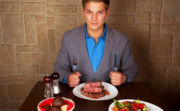 Man at Restaurant Eating Steak