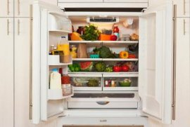 Interior view of refridgerator with healthy food - Karen Moskowitz/The Image Bank/Getty Images