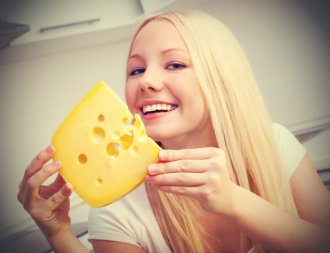 Woman holding cheese