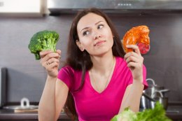 Woman Wondering Whether to Eat Meat or Vegetables