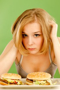 Young Woman Feels Bad About Eating Junk Food, Smaller